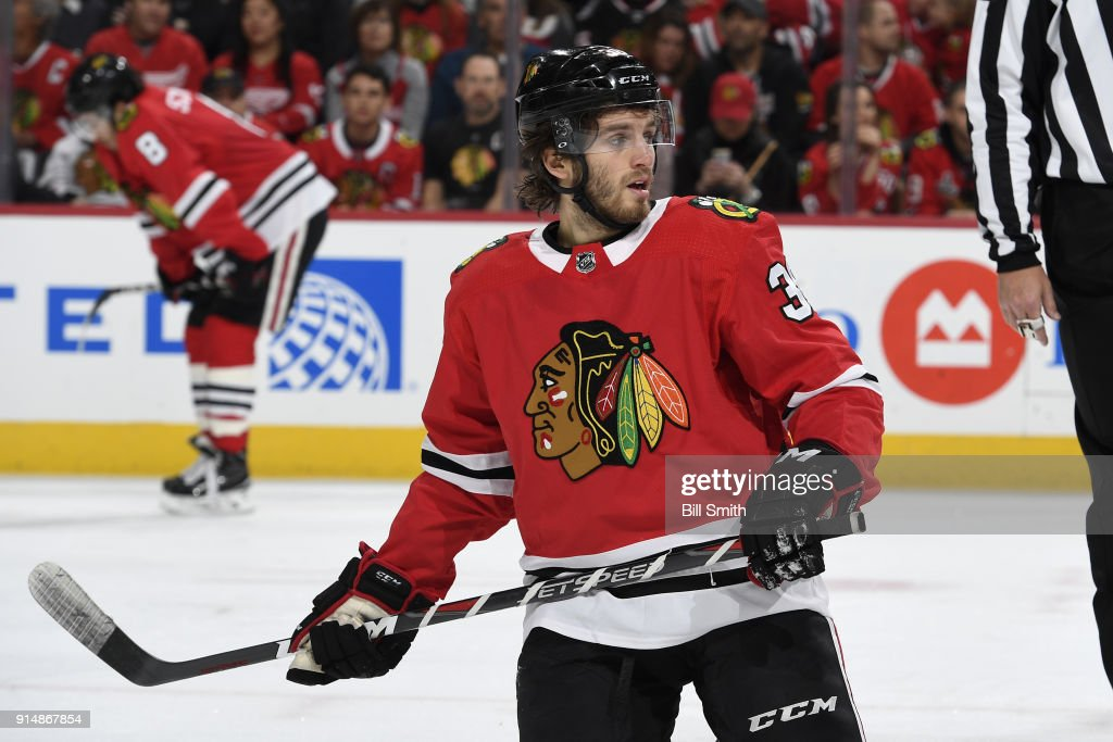 Ryan Hartman #38 of the Chicago Blackhawks looks across the ice in the third period against the Detroit Red Wings at the United Center on January 14, 2018 in Chicago, Illinois. The Detroit Red Wings defeated the Chicago Blackhawks 4-0.
