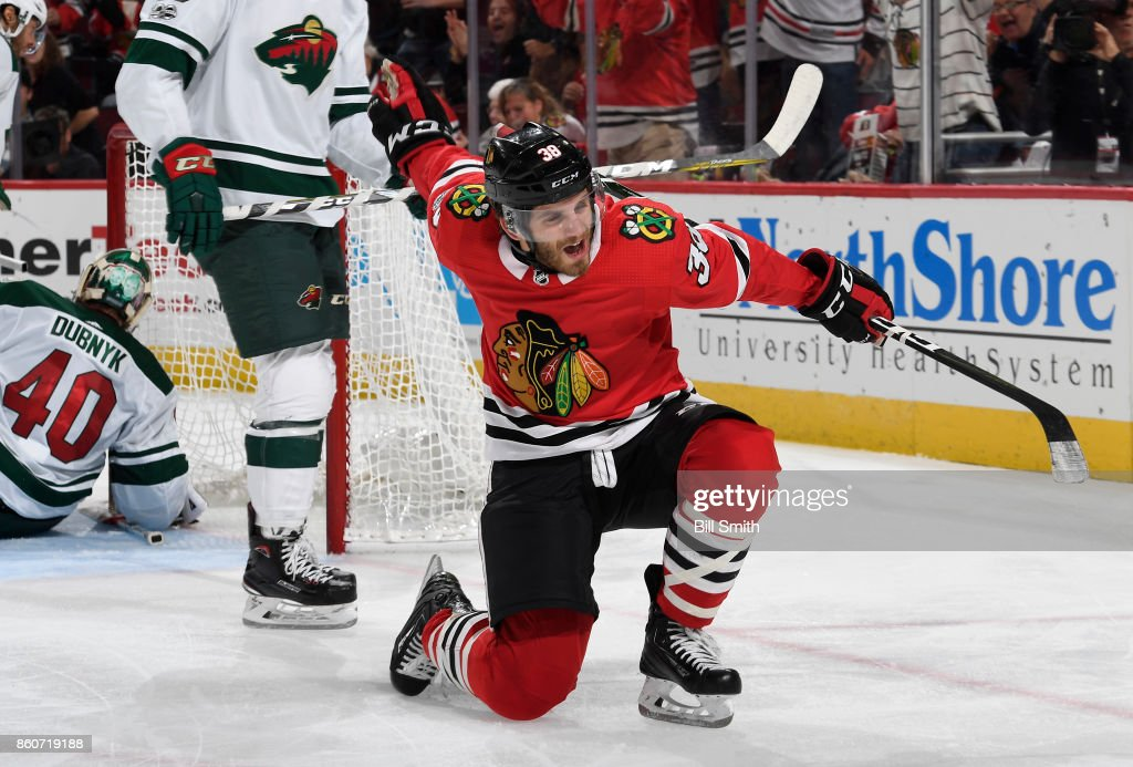 Ryan Hartman #38 of the Chicago Blackhawks reacts after scoring against the Minnesota Wild in the third period at the United Center on October 12, 2017 in Chicago, Illinois.
