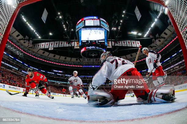 Ryan Hartman of the Chicago Blackhawks skates toward the puck as goalie Sergei Bobrovsky of the Columbus Blue Jackets guards the net in the second...