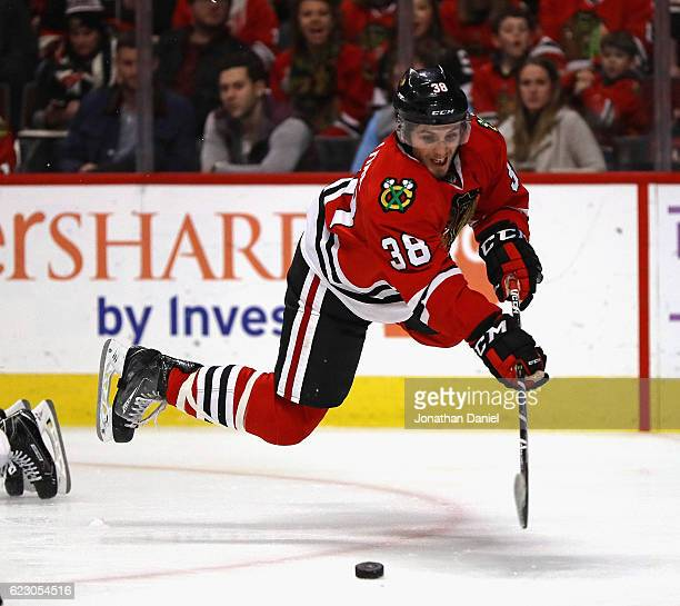 Ryan Hartman of the Chicago Blackhawks tries to get off a shot after being tripped by Alexei Emelin of the Montreal Canadiens at the United Center on...
