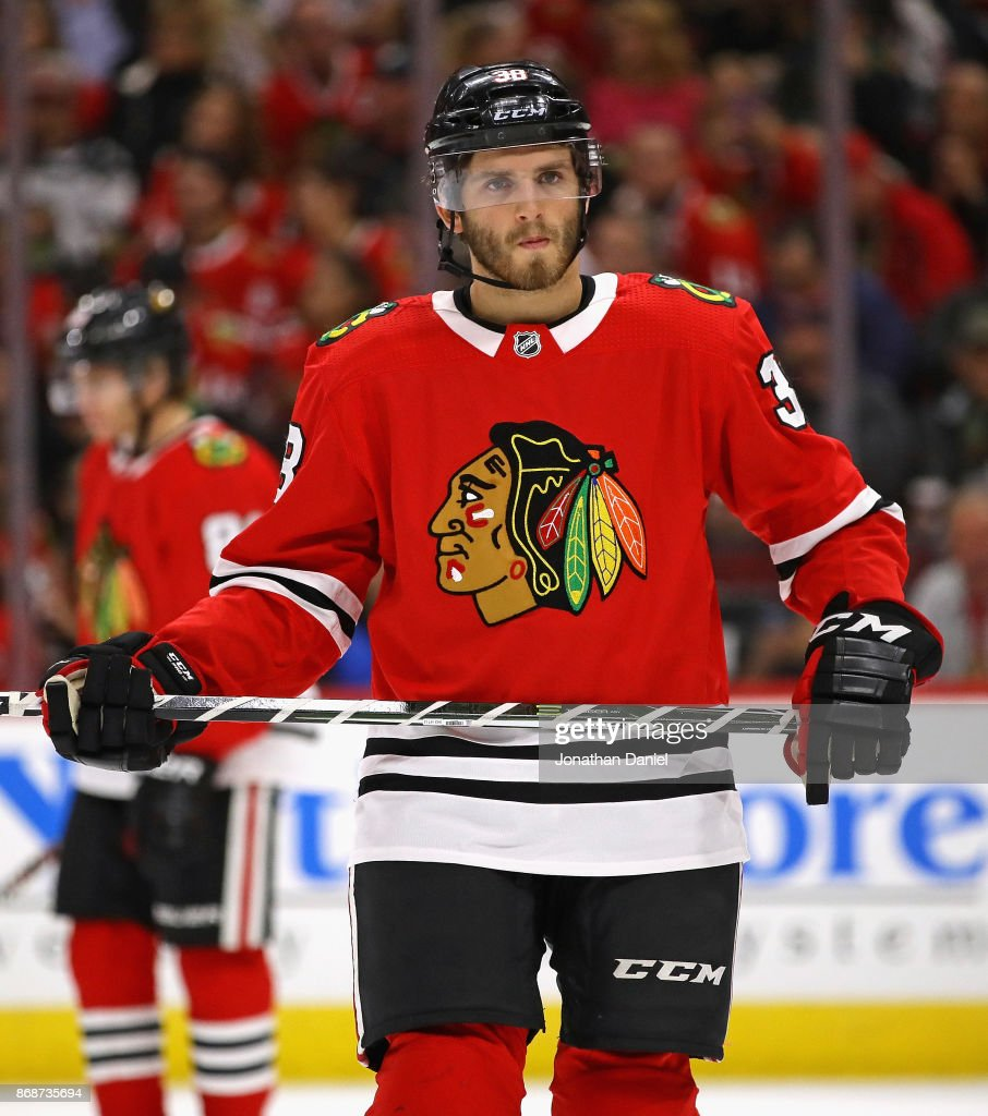 Ryan Hartman #38 of the Chicago Blackhawks waits for the start of play during a time out against the Minnesota Wild at the United Center on October 12, 2017 in Chicago, Illinois. The Wild defeated the Blackhawks 5-2.