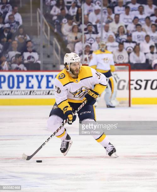 Ryan Hartman of the Nashville Predators plays the puck down the ice during second period action against the Winnipeg Jets in Game Four of the Western...