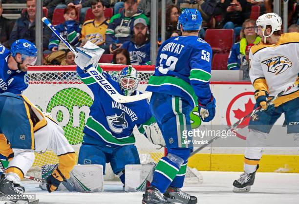 Ryan Hartman of the Nashville Predators scores against Jacob Markstrom of the Vancouver Canucks during their NHL game at Rogers Arena December 6,...
