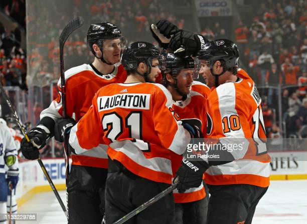 Ryan Hartman of the Philadelphia Flyers celebrates his third period goal against the Toronto Maple Leafs with Samuel Morin Scott Laughton and Corban...