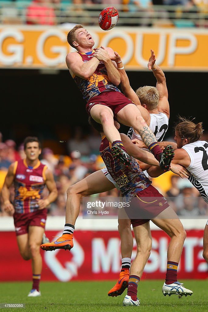 Ryan Harwood of the Lions attempts a mark during the round nine AFL match between the Brisbane Lions and the St Kilda Saints at The Gabba on May 31, 2015 in Brisbane, Australia.