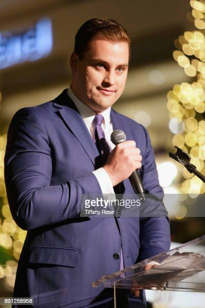 Ryan Hawley speaks onstage at the Village Synagogue and Emmanuelle Chriqui Host Menorah Lighting Ceremony at The Grove on December 12 2017 in Los...