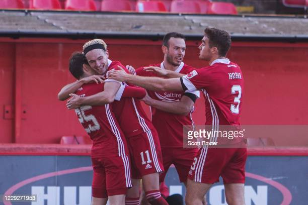 Ryan Hedges of Aberdeen celebrates with teammates after scoring a goal during the Ladbrokes Premiership match between Aberdeen and Celtic at...