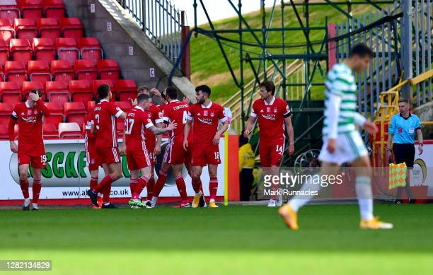 Ryan Hedges of Aberdeen celebrates with teammates after scoring his team's second goal during the Ladbrokes Scottish Premiership match between...