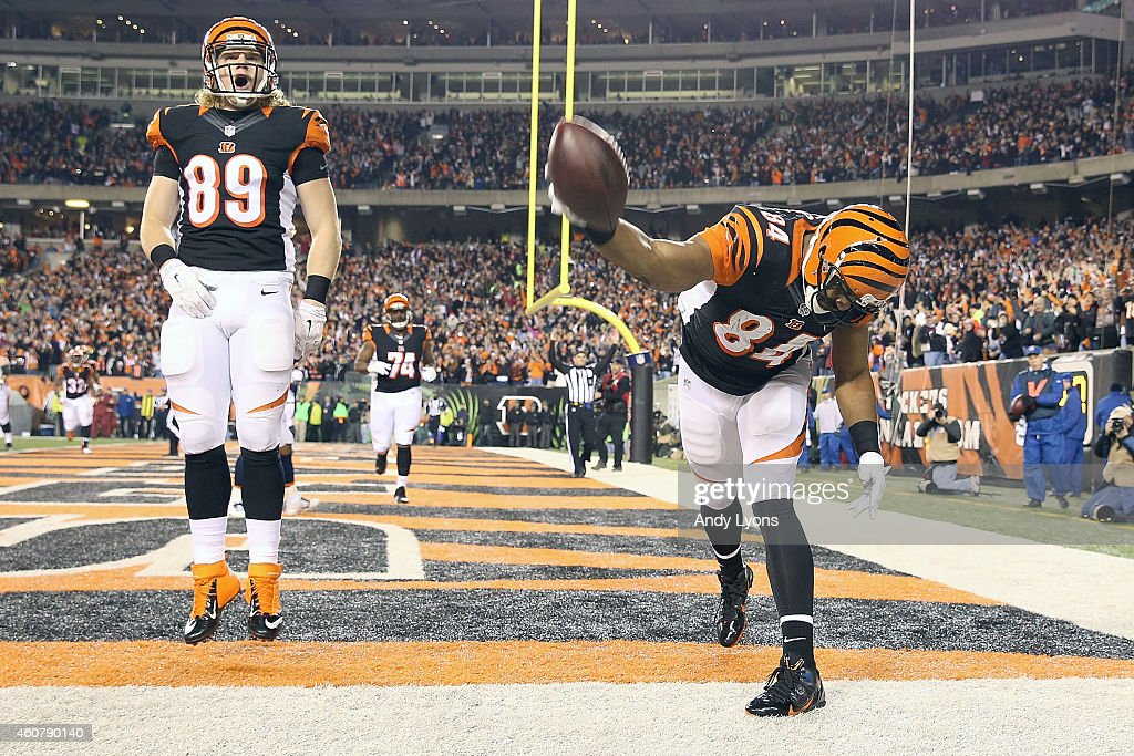 Ryan Hewitt #89 of the Cincinnati Bengals celebrates as Jermaine Gresham #84 of the Cincinnati Bengals spikes the ball after catching a touchdown pass during the second quarter of the game against the Denver Broncos at Paul Brown Stadium on December 22, 2014 in Cincinnati, Ohio.
