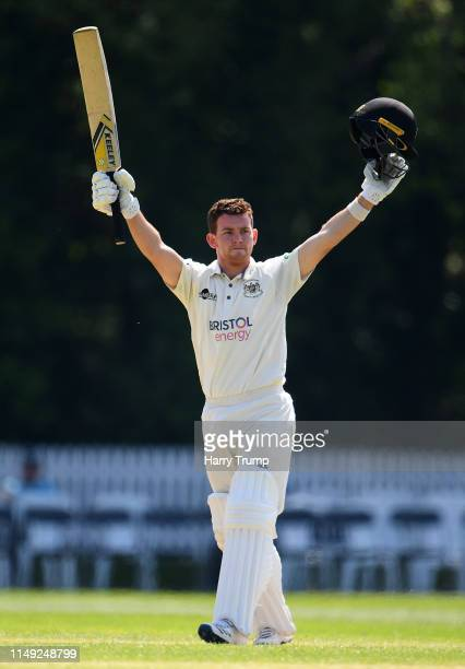 Ryan Higgins of Gloucestershire celebrates his century during Day Two of the Specsavers County Championship Division Two match between Glamorgan and...