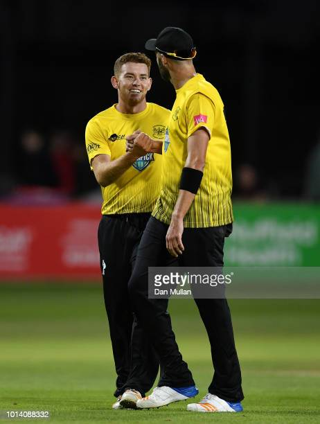Ryan Higgins of Gloucestershire celebrates taking a wicket with Andrew Tye of Gloucestershire during the Vitality Blast match between Gloucestershire...