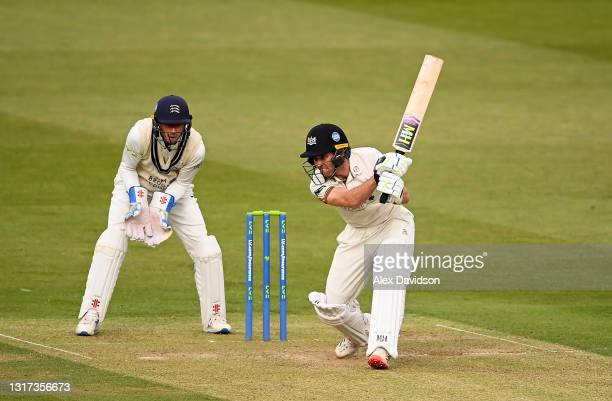 Ryan Higgins of Gloucestershire hits runs watched on by John Simpson of Middlesex during Day Two of the LV= Insurance County Championship match...