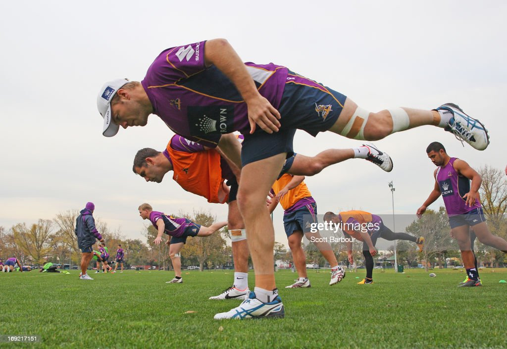 Ryan Hinchcliffe and Cameron Smith of the Storm stretch during a Melbourne Storm NRL training session at Gosch's Paddock on May 22, 2013 in Melbourne, Australia.
