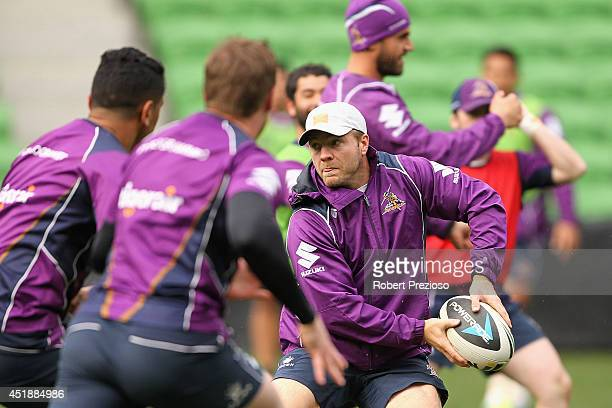 Ryan Hinchcliffe looks to offload the ball during a Melbourne Storm NRL training session at AAMI Park on July 9 2014 in Melbourne Australia