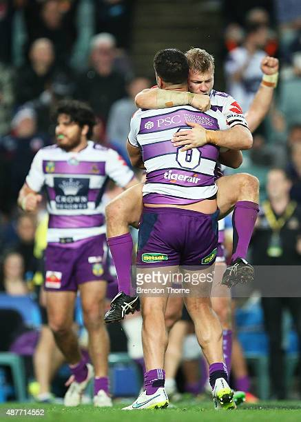 Ryan Hinchcliffe of the Storm celebrates with team mate Jesse Bromwich at full time after victory over the Roosters following the NRL qualifying...