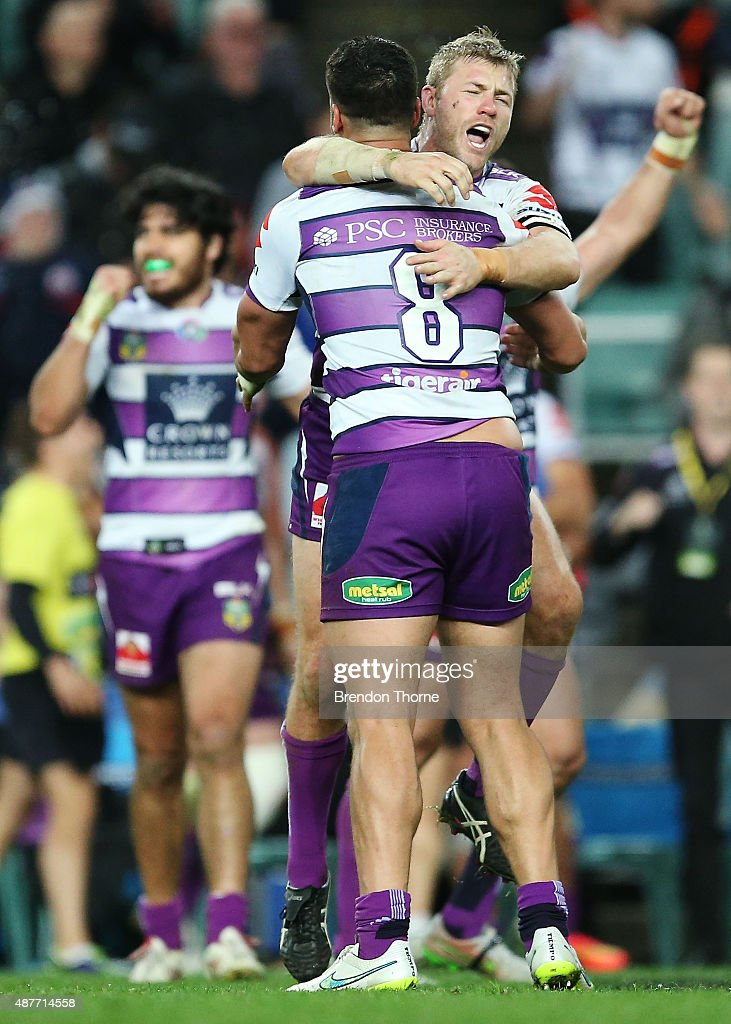 Ryan Hinchcliffe of the Storm celebrates with team mate Jesse Bromwich at full time after victory over the Roosters following the NRL qualifying final match between the Sydney Roosters and the Melbourne Storm at Allianz Stadium on September 11, 2015 in Sydney, Australia.