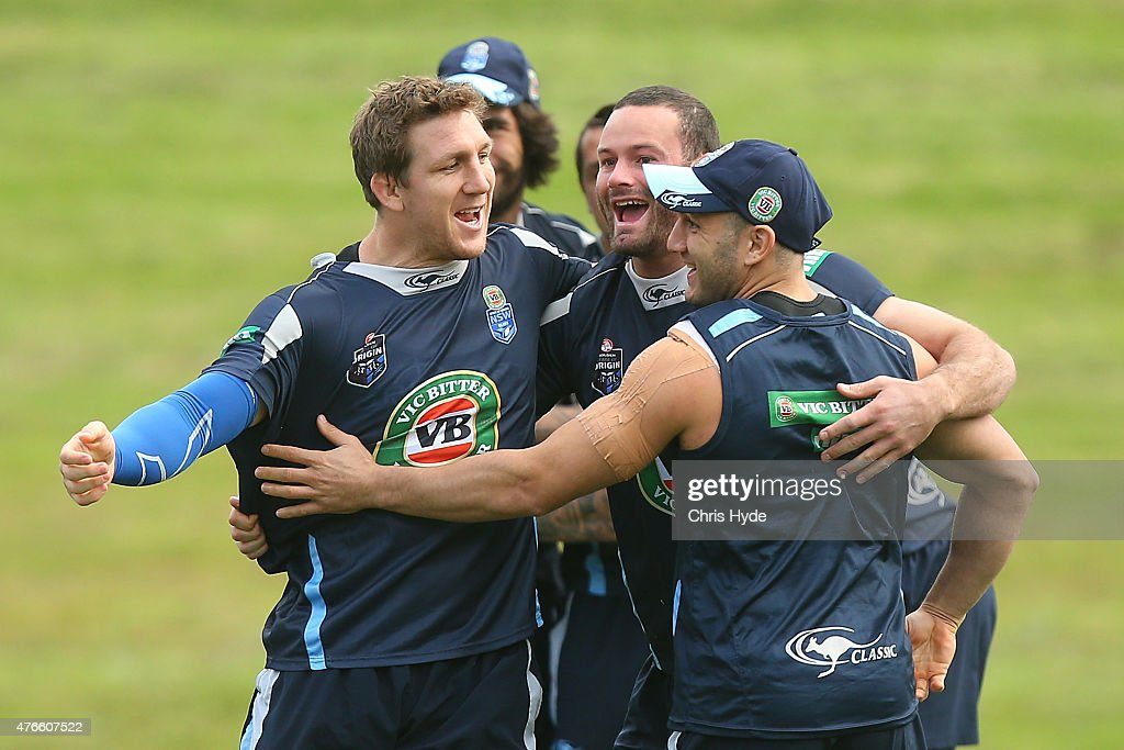 Ryan Hoffman, Boyd Cordner and Robbie Farah warm up during the New South Wales Blues State of Origin team training session at the Novotel on June 11, 2015 in Coffs Harbour, Australia.