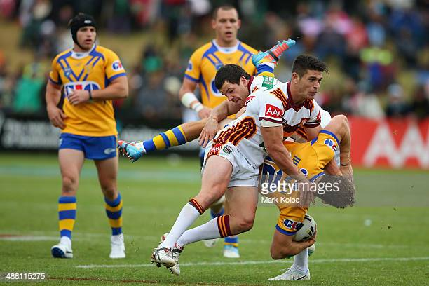 Ryan Hoffman of City is tackled by Jarrod Mullen and Adam Docker of Country during the Origin match between City and Country at Caltex Park on May 4...