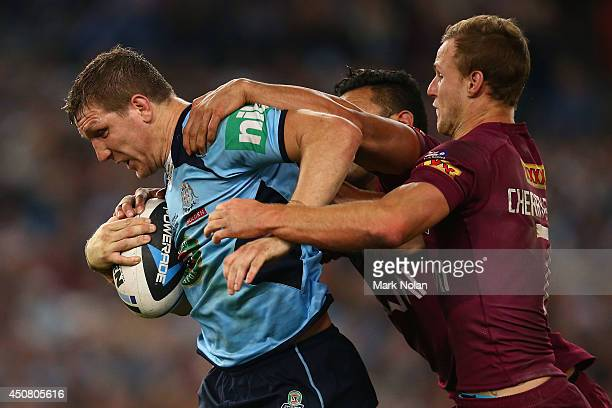 Ryan Hoffman of the Blues is tackled during game two of the State of Origin series between the New South Wales Blues and the Queensland Maroons at...