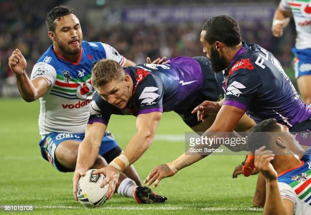 Ryan Hoffman of the Melbourne Storm scores a try during the round eight NRL match between the Melbourne Storm and New Zealand Warriors at AAMI Park...