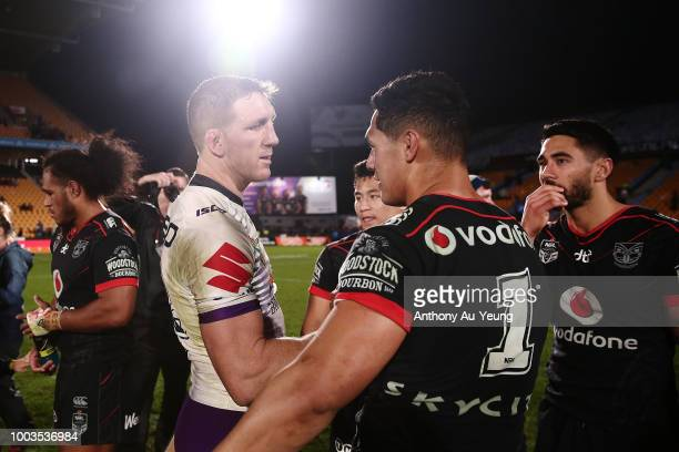 Ryan Hoffman of the Storm catches up with Roger TuivasaSheck of the Warriors after the round 19 NRL match between the New Zealand Warriors and the...