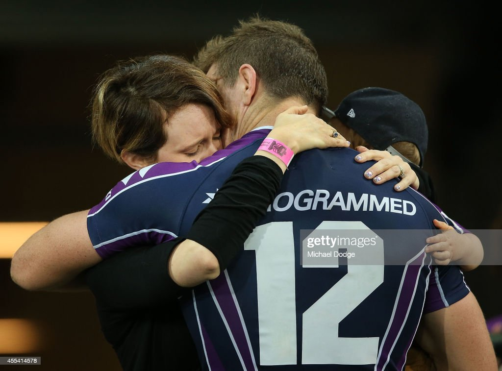 Ryan Hoffman of the Storm is hugged by his wife and his son after playing his last game with the club during the NRL 2nd Elimination Final match between the Melbourne Storm and the Canterbury Bankstown Bulldogs at AAMI Park on September 14, 2014 in Melbourne, Australia.
