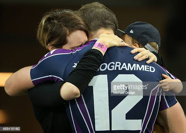 Ryan Hoffman of the Storm is hugged by his wife and his son after playing his last game with the club during the NRL 2nd Elimination Final match...