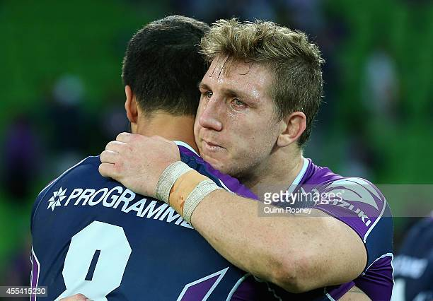 Ryan Hoffman of the Storm is hugged by Jesse Bromwich after playing his last game for the Storm during the NRL 2nd Elimination Final match between...