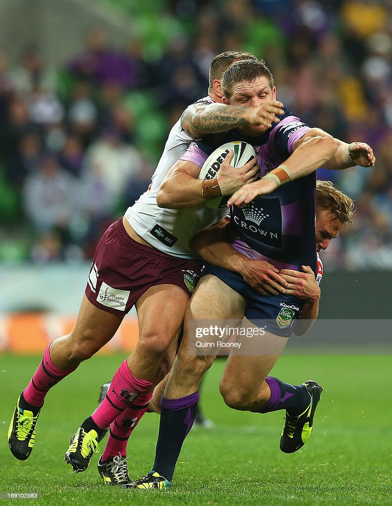 Ryan Hoffman of the Storm is tackled by Anthony Watmough of the Sea Eagles during the round 10 NRL match between the Melbourne Storm and the Manly Sea Eagles at AAMI Park on May 20, 2013 in Melbourne, Australia.