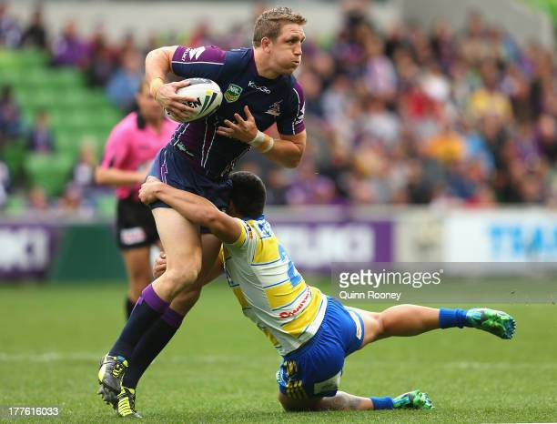 Ryan Hoffman of the Storm is tackled by Ken Sio of the Eels during the round 24 NRL match between the Melbourne Storm and the Parramatta Eels at AAMI...