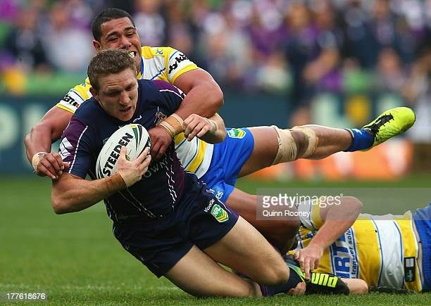 Ryan Hoffman of the Storm is tackled by Vai Toutai of the Eels during the round 24 NRL match between the Melbourne Storm and the Parramatta Eels at...