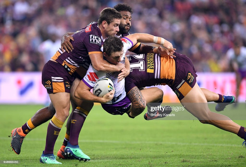 Ryan Hoffman of the Storm is tackled during the round seven NRL match between the Brisbane Broncos and the Melbourne Storm at Suncorp Stadium on April 20, 2018 in Brisbane, Australia.