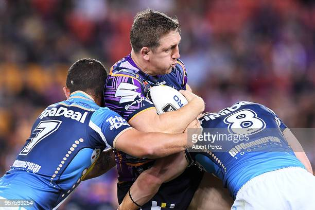 Ryan Hoffman of the Storm is tackled during the round ten NRL match between the Melbourne Storm and the Gold Coast Titans at Suncorp Stadium on May...