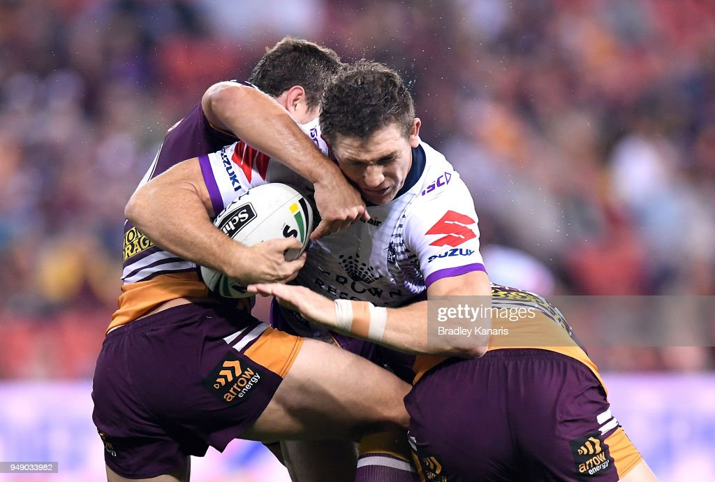 Ryan Hoffman of the Storm takes on the defence during the round seven NRL match between the Brisbane Broncos and the Melbourne Storm at Suncorp Stadium on April 20, 2018 in Brisbane, Australia.