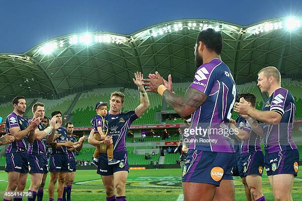 Ryan Hoffman of the Storm waves good bye to the crowd after playing his last game for the Storm during the NRL 2nd Elimination Final match between...