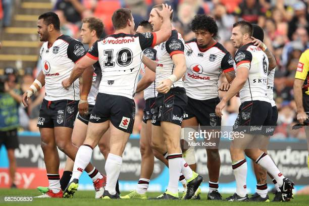 Ryan Hoffman of the Warriors celebrates with his team mates after scoring a try during the round 10 NRL match between the Penrith Panthers and the...