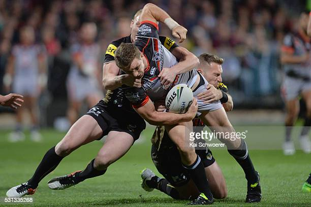 Ryan Hoffman of the Warriors is tackled during the round 10 NRL match between the Penrith Panthers and the New Zealand Warriors at AMI Stadium on May...