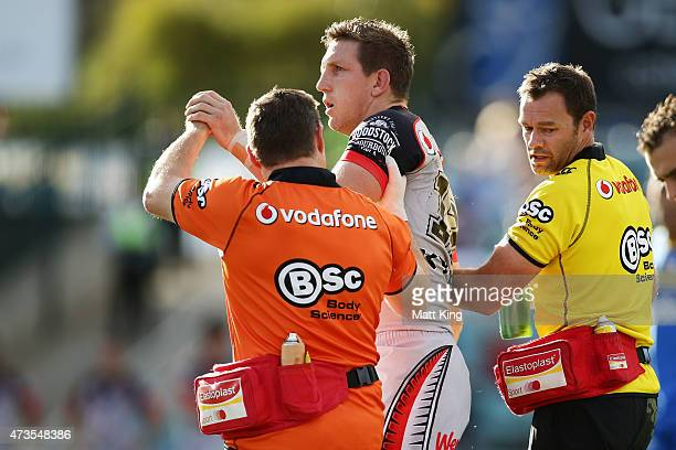 Ryan Hoffman of the Warriors leaves the field with a concussion injury during the round 10 NRL match between the Parramatta Eels and the New Zealand...
