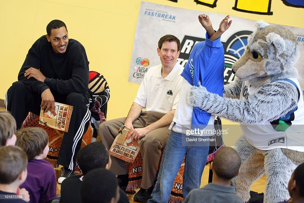 Ryan Hollins, mascot Crunch and broadcaster Alan Horton of the Minnesota Timberwolves host a Reading Time-out at the Midway YMCA on March 29, 2010 in St. Paul, Minnesota.