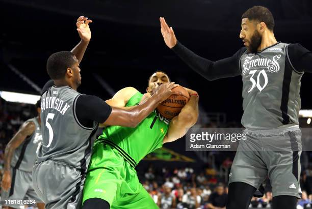 Ryan Hollins of the Aliens battles for the ball against the Enemies during week four of the BIG3 three on three basketball league at Dunkin' Donuts...