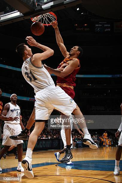 Ryan Hollins of the Cleveland Cavaliers dunks against Yi Jianlian of the Washington Wizards at the Verizon Center on November 6 2010 in Washington DC...