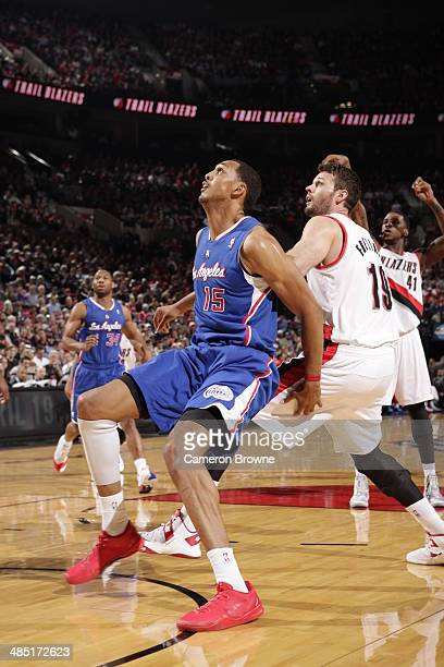 Ryan Hollins of the Los Angeles Clippers boxes out against Joel Freeland of the Portland Trail Blazers during the game on April 16 2014 at the Moda...
