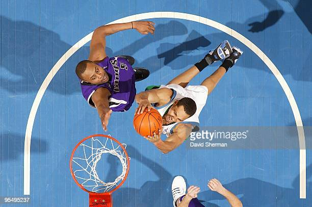 Ryan Hollins of the Minnesota Timberwolves goes to the basket against Kenny Thomas of the Sacramento Kings during the game on December 18 2009 at the...