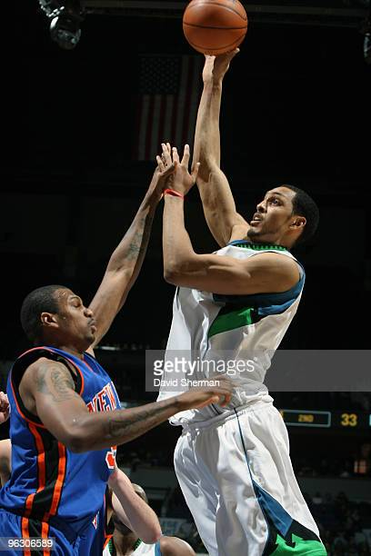 Ryan Hollins of the Minnesota Timberwolves shoots over Jonathan Bender of the New York Knicks during the game on January 31 2010 at the Target Center...