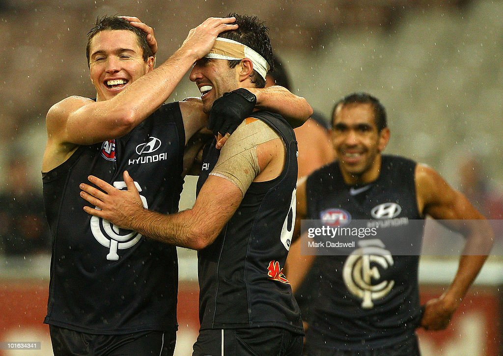 Ryan Houlihan of the Blues celebrates a goal with Kade Simpson during the round 11 AFL match between the Carlton Blues and the Melbourne Demons at Melbourne Cricket Ground on June 5, 2010 in Melbourne, Australia.