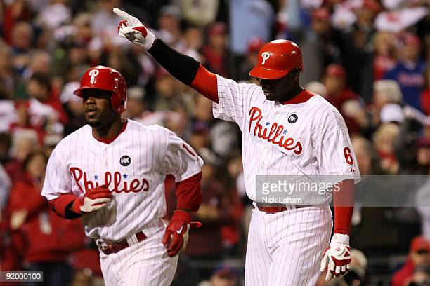 Ryan Howard and Jimmy Rollins of the Philadelphia Phillies celebrate after they both scored on Howard's 2run home run in the bottom of the first...
