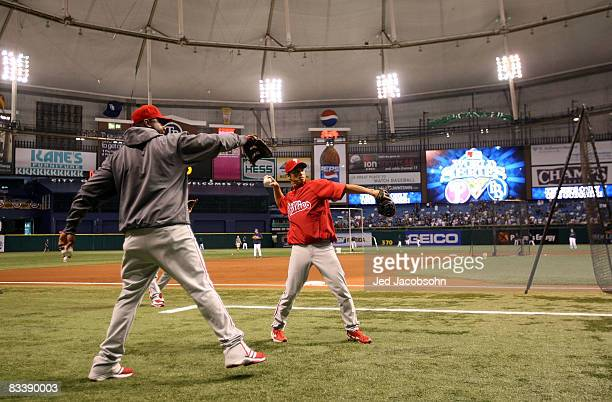 Ryan Howard and So Taguchi of the Philadelphia Phillies warm up during batting practices before game one of the 2008 MLB World Series against the...
