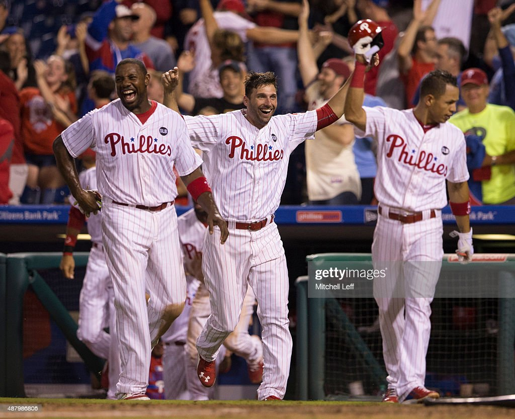 Ryan Howard #6, Jeff Francoeur #3, and Cesar Hernandez #16 of the Philadelphia Phillies celebrate after the walk-off two-run home run hit by Cody Asche #25 (NOT PICTURED) in the bottom of the ninth inning against the Chicago Cubs on September 12, 2015 at Citizens Bank Park in Philadelphia, Pennsylvania. The Phillies defeated the Cubs 7-5.