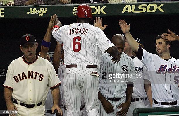 Ryan Howard of of the Philadelphia Phillies celebrates after scoring during the Aeon All Star Series 2006 against Japan All-Star at Tokyo Dome on...