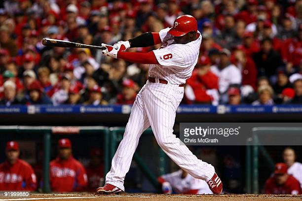 Ryan Howard of of the Philadelphia Phillies hits a 2-run home run in the bottom of the first inning against the Los Angeles Dodgers in Game Four of...